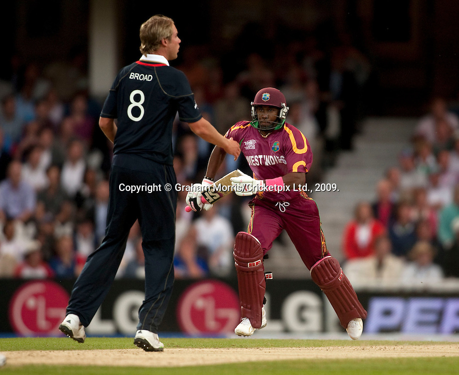 Dwayne Bravo runs off a ball from Stuart Broad during the ICC World Twenty20 Cup match between West Indies and England at The Oval. Photo © Graham Morris (Tel: +44(0)20 8969 4192 Email: sales@cricketpix.com)