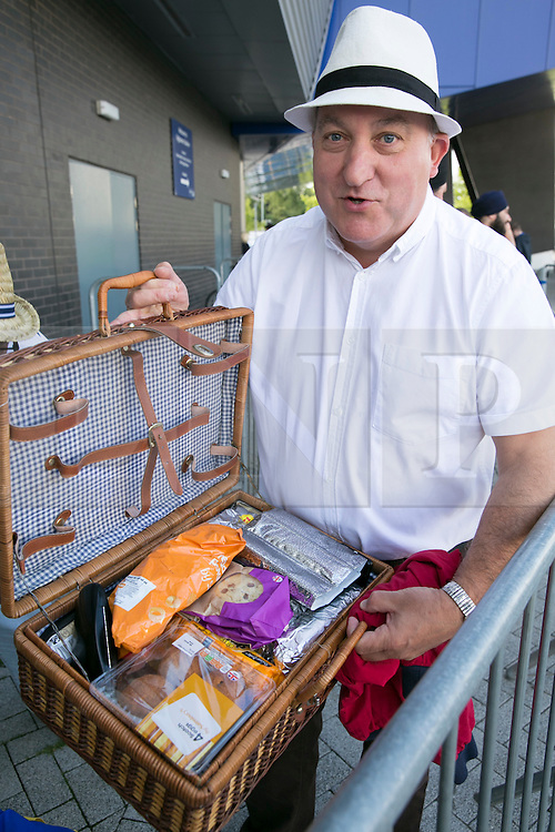 © Licensed to London News Pictures. 29_07_2015. Pictured, England fans who have come prepared. Roy from Redditch, Worcs with his well stocked hamper. Cricket fans arriving at Edgbaston cricket  ground for the start of the third test against Australia. Photo credit : Dave Warren/LNP