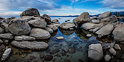 Large bouldersline the shore at Lake Tahoe, NV