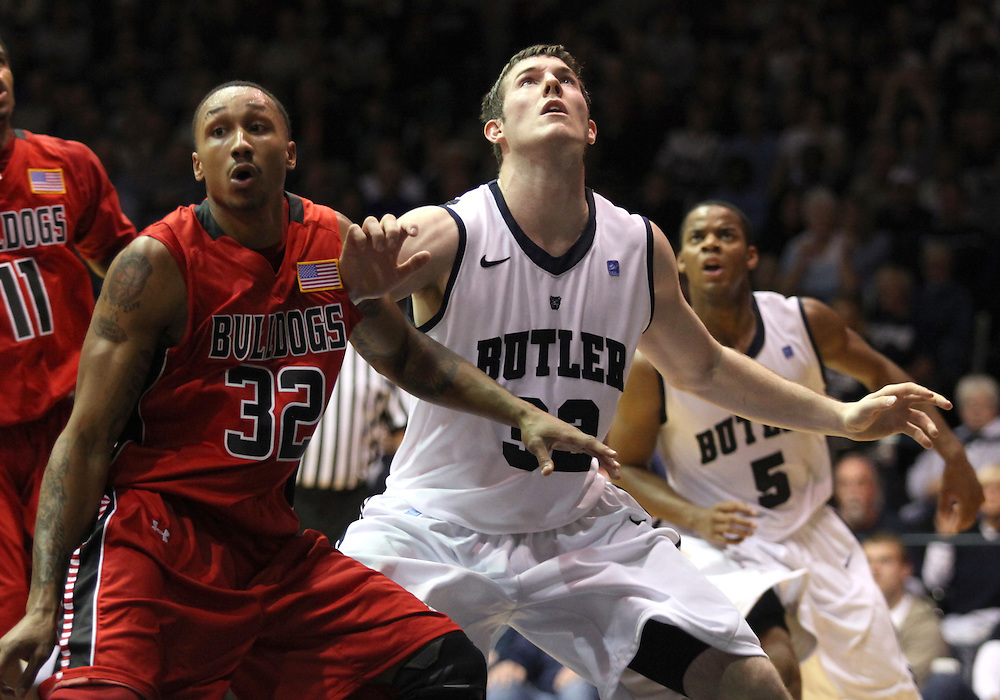 November 23, 2011: Butler's Garrett Butcher goes for a rebound with  Gardner-Webb's Tashan Newsome during the game at Hinkle Fieldhouse in Indianapolis, Ind. Butler won 68-66.