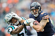 CHICAGO, IL - OCTOBER 22:  Zach Miller #76 of the Chicago Bears runs the ball and stiff arms Shaq Thompson #54 of the Carolina Panthers at Soldier Field on October 22, 2017 in Chicago, Illinois.  The Bears defeated the Panthers 17-3.  (Photo by Wesley Hitt/Getty Images) *** Local Caption *** Zach Miller; Shaq Thompson