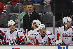 Jan 25, 2013; Newark, NJ, USA; Washington Capitals head coach Adam Oates stands behind the bench during the second period at the Prudential Center.