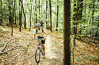 Man Mountain Biking in Blue Ridge Mountains Mountain biking in the Blue Ridge Mountains. Mountain biking man, woman, kids in virgina, north carolina, montana, and california.