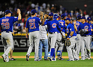 Apr. 29 2011; Phoenix, AZ, USA; Chicago Cubs outfielder Alfonso Soriano(12) celebrates with teammates after defeated the Diamondbacks 4-2 at Chase Field. Mandatory Credit: Jennifer Stewart-US PRESSWIRE..