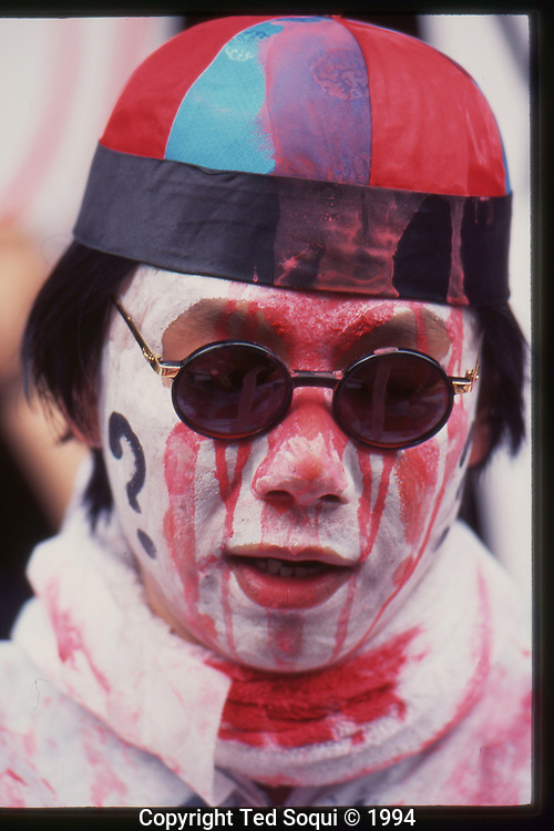 The OJ Simpson trial and media circus.<br /> A bizarre performance artist doused in red paint and dancing in front of a sign that reads &quot;Chines Gods Proclaim OJ Innocent.&quot;