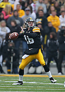 November 05, 2011: Iowa Hawkeyes quarterback James Vandenberg (16) passes the ball during the first quarter of the NCAA football game between the Michigan Wolverines and the Iowa Hawkeyes at Kinnick Stadium in Iowa City, Iowa on Saturday, November 5, 2011. Iowa defeated Michigan 24-16.