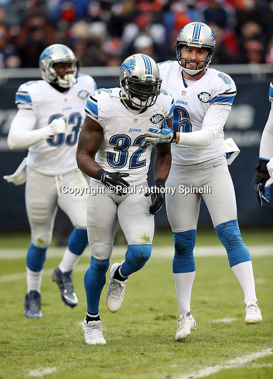 Detroit Lions strong safety James Ihedigbo (32) gets congratulated by Detroit Lions punter Sam Martin (6) after making a tackle on a first quarter kick return during the NFL week 17 regular season football game against the Chicago Bears on Sunday, Jan. 3, 2016 in Chicago. The Lions won the game 24-20. (©Paul Anthony Spinelli)