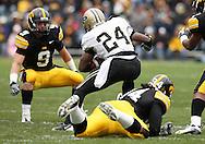 15 NOVEMBER 2008: Purdue running back Kory Sheets (24) tries to get around Iowa defensive back Tyler Sash (9) in the first half of an NCAA college football game against Purdue, at Kinnick Stadium in Iowa City, Iowa on Saturday Nov. 15, 2008. Iowa beat Purdue 22-17.