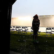 A young fan of the Boston Cannons is seen on the side of the field, waiting for the end of a rain delay during the game at Harvard Stadium on May 10, 2014 in Boston, Massachusetts. (Photo by Elan Kawesch)