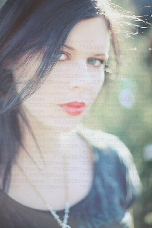 Simple portrait of a pretty young woman with dark hair's face