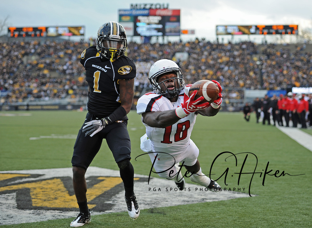 Sports Illustrated -- Texas Tech Red Raiders wide receiver Eric Ward (18) makes a diving catch in the back of the end zone against Missouri Tigers defensive back Kip Edwards (1) during the first quarter at Faurot Field.