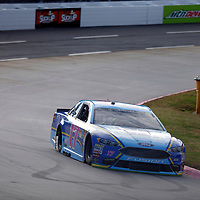 Ricky Stenhouse, Jr (17) races through turn three to practice  for the First Data 500 at Martinsville Speedway in Martinsville, Virginia.