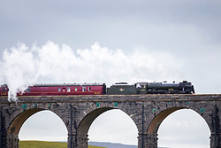 © Licensed to London News Pictures. 07/08/2017. Ribblehead UK. The 46115 Scots Guardsman crosses the Ribblehead Viaduct in the Yorkshire Dales this afternoon on a mostly overcast day in Yorkshire. Photo credit: Andrew McCaren/LNP