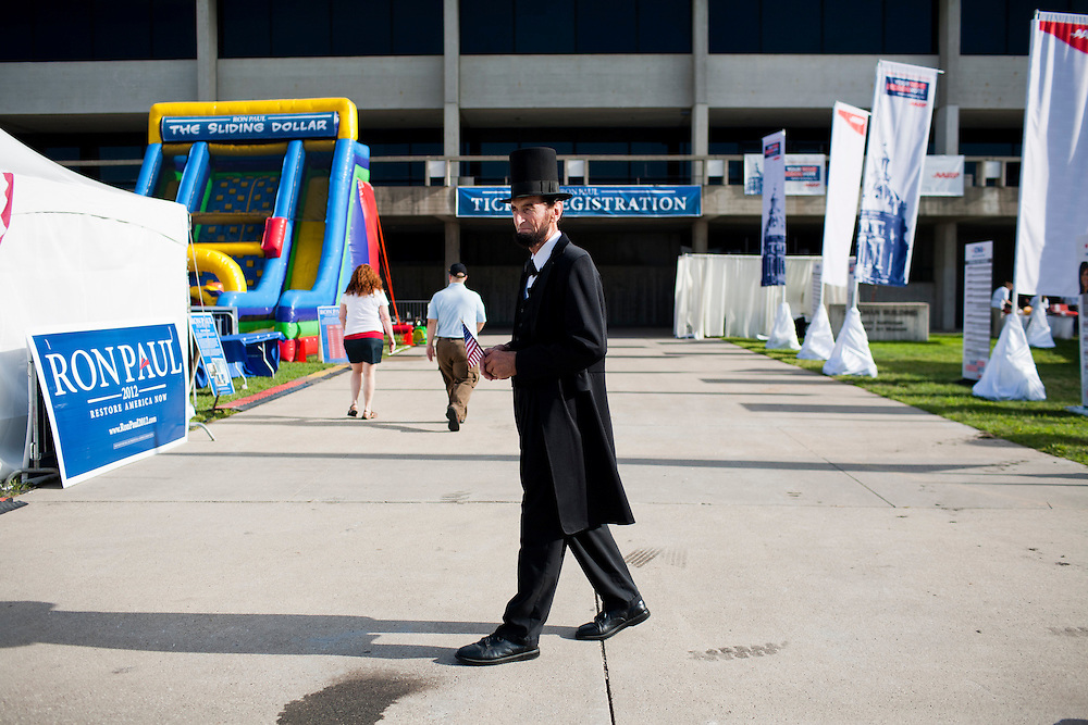 A man dressed as Abraham Lincoln walks the grounds of the Iowa Republican Straw Poll on Saturday, August 13, 2011 in Ames, IA.