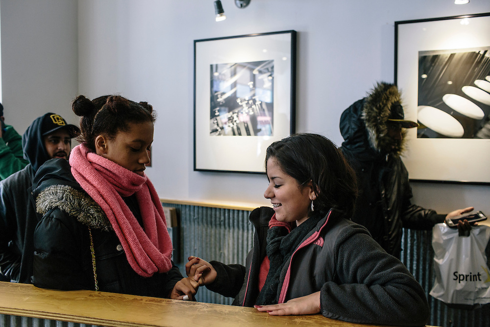 Daniela Shia-Sevilla, 15, and best friend Autumnreign Bush, 15, left, wait in line to get burritos before going to see movies in Silver Spring.
