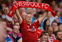 "DUBLIN, REPUBLIC OF IRELAND - Saturday, August 4, 2018: A Liverpool supporter holds up a scarf and sings ""You'll Never Walk Alone"" during the preseason friendly match between SSC Napoli and Liverpool FC at Landsdowne Road. (Pic by David Rawcliffe/Propaganda)"