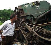 Indian Railway officials are inspecting the situation, when anti-talks faction of the National Democratic Front of Bodoland (Ranjan Daimary Group) that is, shortly say - NDFB (R), one of the insurgent group of northeast India, triggered a powerful blast, which flung the locomotive and two numbers of coach of a train (known as - Garib Rath Express) bound for Kolkata (capital of Indian State West Bengal) from Guwahati, the capital of Eastern Indian State, Assam at around 02:28 am, killing a 06-year-old boy (Durlav Sethia) and injuring 23-numbers of  other at Gossaigaon in Kokrajhar district of the Indian State Assam on 08th July, 2010, during Bodo militants, straining at the leash after the arrest of their leader. Pic-Shib Shankar Chatterjee