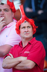 BLACKPOOL, ENGLAND - Sunday, April 10, 2011: Arsenal's supporters wearing red and white Mohican wigs before the Premiership match against Blackpool at Bloomfield Road. (Photo by David Rawcliffe/Propaganda)