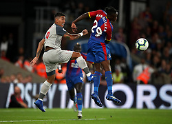 Liverpool's Roberto Firmino (left) and Crystal Palace's Aaron Wan-Bissaka during the Premier League match at Selhurst Park, London.
