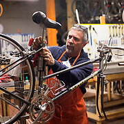 Allen Kirkwood volunteers at The Broke Spoke, located in the Bread Box in Lexington, Ky., Tuesday, December 15, 2015. The bike shop is an all-volunteer organization that provides inexpensive bikes, repairs and parts to those who need them.(Photo by David Stephenson)