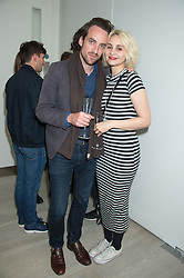 TUPPENCE MIDDLETON and ROBERT FRY at the opening of the exhibition Champagne Life in celebration of 30 years of The Saatchi Gallery, held on 12th January 2016 at The Saatchi Gallery, Duke Of York's HQ, King's Rd, London.
