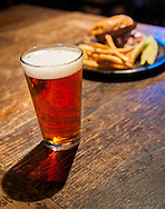 Hamburger and fries with a beer at Falling Rock Tap House in Denver, Colorado.