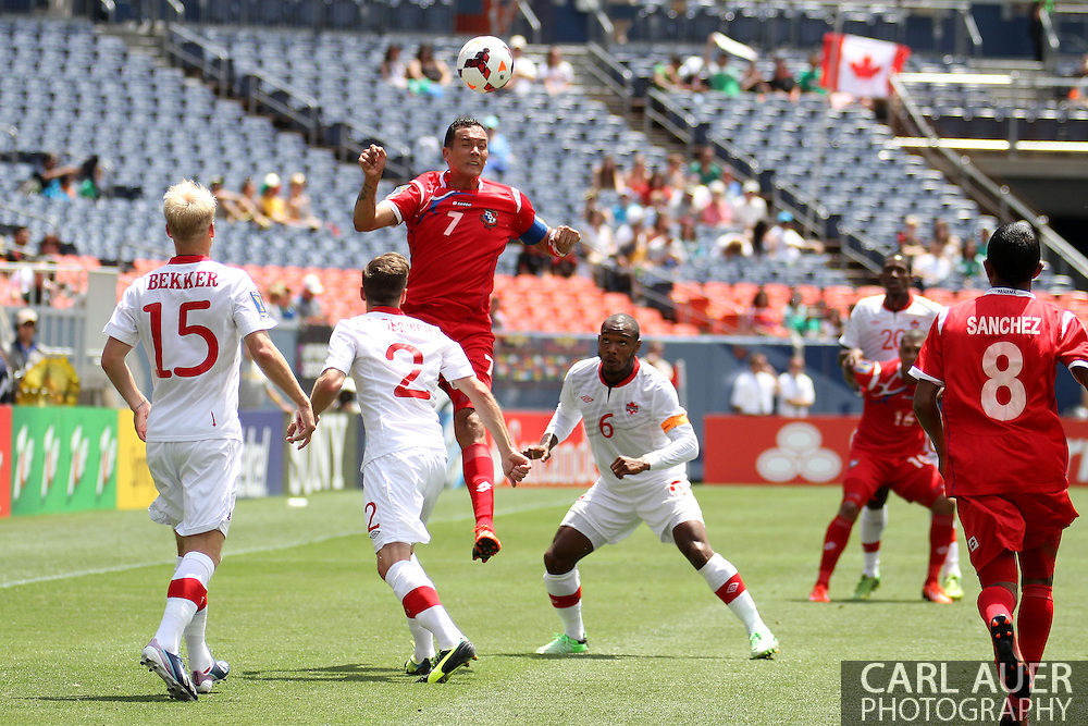 July 14 2013:  Panama Forward Blas Perez (7) elevates over Canada Midfield Kyle Bekker (15), Defender Nikolas Ledgerwood (2) and Midfield Julian De Guzman (6) during the first half of play in the CONCACAF Gold Cup soccer match between Panama and Canada at Sports Authority Field in Denver, CO. USA.