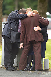 © Licensed to London News Pictures . 30/08/2012 . Manchester, UK . Mourners hug before the funeral of Winnie Johnson at St Chrysostom's Church, Victoria Park in Manchester on August 30, 2012. Winnie Johnson devoted her life to finding the body of her 12 year old son Keith Bennett who was murdered by Moors Murderer Ian Brady and Myra Hindley. Photo credit : Joel Goodman/LNP