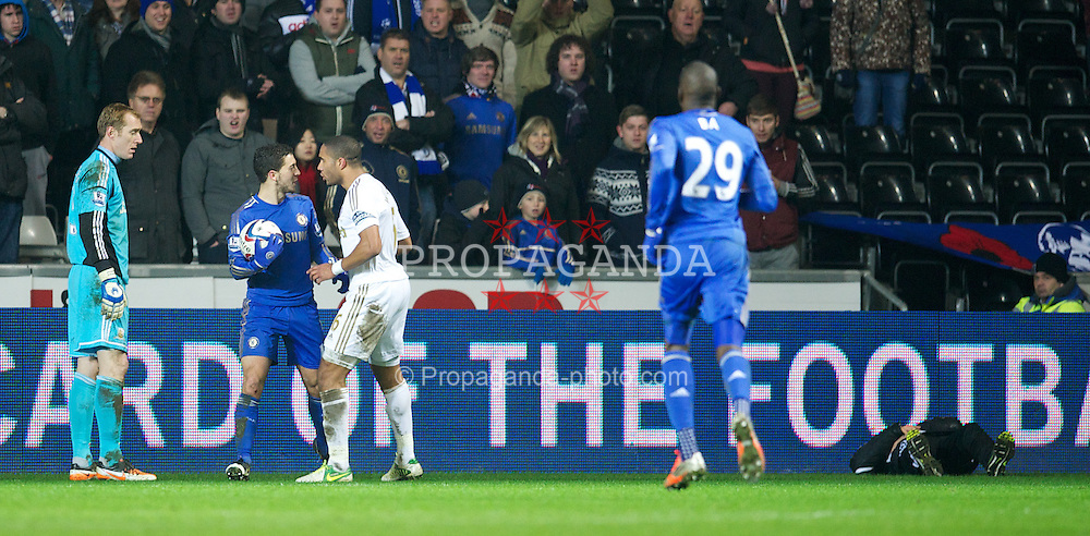 SWANSEA, WALES - Wednesday, January 23, 2013: Swansea City's captain Ashley Williams clashes with Chelsea's Eden Hazard after he kicked a ball-boy (right) during the Football League Cup Semi-Final 2nd Leg match at the Liberty Stadium. (Pic by David Rawcliffe/Propaganda)