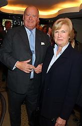 MR & MRS CHRISTOPHER SPENCE  at The Sir Peter O'Sullevan Charitable Trust Lunch at The Savoy, London on 23rd November 2005.<br />