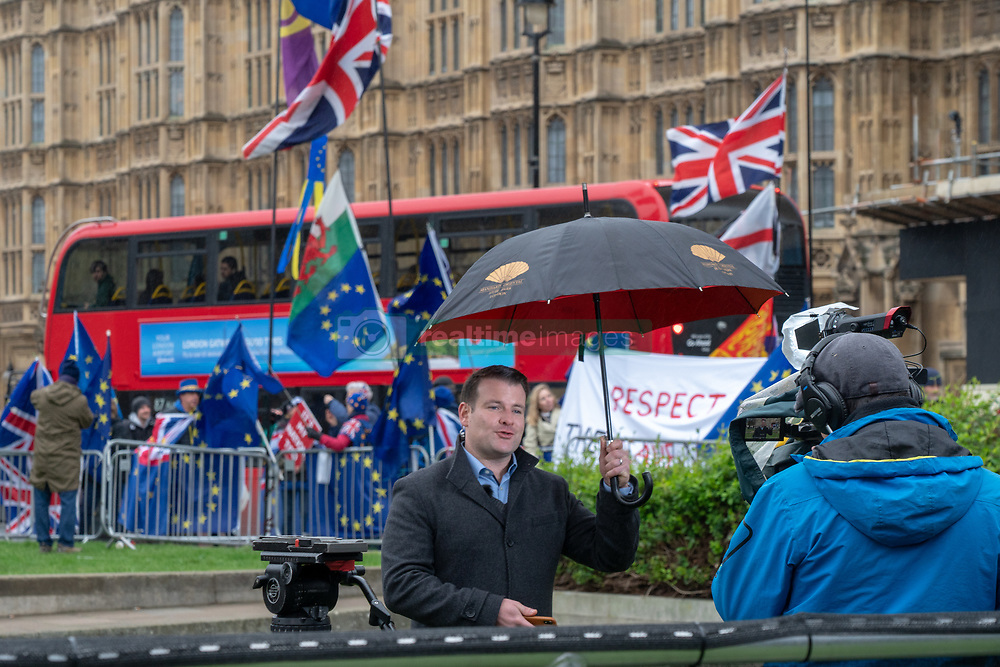 A journalist on College Green outside the UK Houses of Parliament in London ahead of the second so-called significant vote in House of Commons on Theresa May's revised EU Withdrawal (Brexit) Agreement. Photo date: Tuesday, March 12, 2019. Photo credit should read: Richard Gray/EMPICS