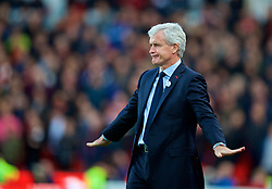 STOKE-ON-TRENT, ENGLAND - Saturday, September 9, 2017: Stoke City's manager Mark Hughes signals the match is over during the FA Premier League match between Stoke City and Manchester United at the Bet365 Stadium. (Pic by David Rawcliffe/Propaganda)