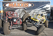 Maxxis showed off their tire designs inside the convention on shiny wheels, and put them to use outside on their team rockcrawlers