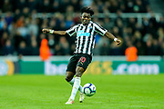 Christian Atsu (#30) of Newcastle United controls the ball during the Premier League match between Newcastle United and Liverpool at St. James's Park, Newcastle, England on 4 May 2019.