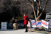 Visitors stand outside the Tarrant County Plaza Building, one of several primary election polling locations in Fort Worth, Texas on March 4, 2014. (Cooper Neill / for The Texas Tribune)