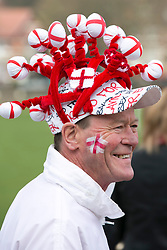 © Licensed to London News Pictures. 23/04/2015. Nottingham, UK. The Nottingham St George's parade took part today. The parade met in Forest Recreation Ground. An estimated two hundred people with trucks playing patriotic music and horses dressed in flags made their way along the streets into the City Centre. Pictured, a full headdress. Photo credit : Dave Warren/LNP