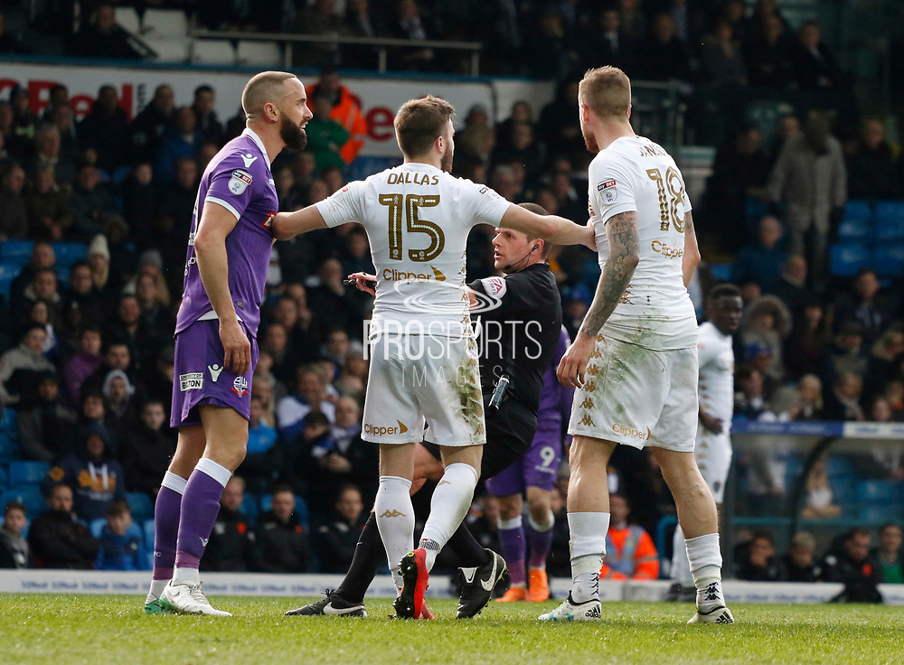 Referee Geoff Eltringham arrives as Bolton Wanderers forward Aaron Wilbraham and Leeds United defender Pontus Jansson square up during the EFL Sky Bet Championship match between Leeds United and Bolton Wanderers at Elland Road, Leeds, England on 30 March 2018. Picture by Paul Thompson.