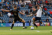 Callum Robinson of Preston North End is tackled by Shaun Hutchinson of Millwall during the EFL Sky Bet Championship match between Preston North End and Millwall at Deepdale, Preston, England on 23 September 2017. Photo by Paul Thompson.
