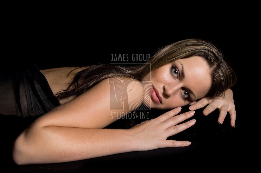 Medium shot of a beautiful female model on black