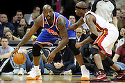 Feb 4, 2010; Cleveland, OH, USA; Cleveland Cavaliers center Shaquille O'Neal (33) looks for a way around Miami Heat forward Dorell Wright (1) during the third quarter at Quicken Loans Arena. The Cavaliers beat the Heat 102-86. Mandatory Credit: Jason Miller-US PRESSWIRE