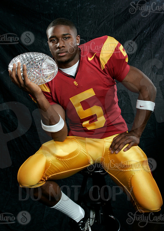 7 April 2005: USC Trojan Reggie Bush with the National Championship Crystal Football Trophy  For Editorial Use ONLY. NCAA College Football  Heisman Trophy winner Reggie Bush of the USC Trojans. Now a NFL player for the New Orleans Saints.