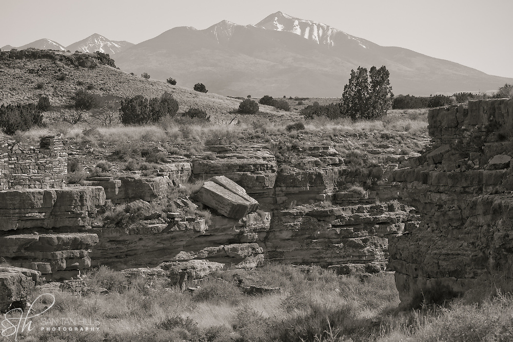 Small canyon ruins with the San Francisco Peaks in the Background - Wupatki National Monument, AZ