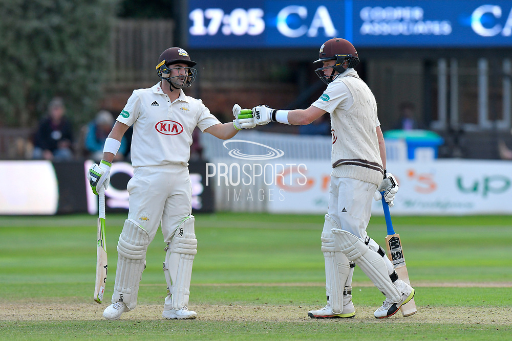 Dean Elgar of Surrey and Ollie Pope of Surrey touch gloves during the opening day of the Specsavers County Champ Div 1 match between Somerset County Cricket Club and Surrey County Cricket Club at the Cooper Associates County Ground, Taunton, United Kingdom on 18 September 2018.