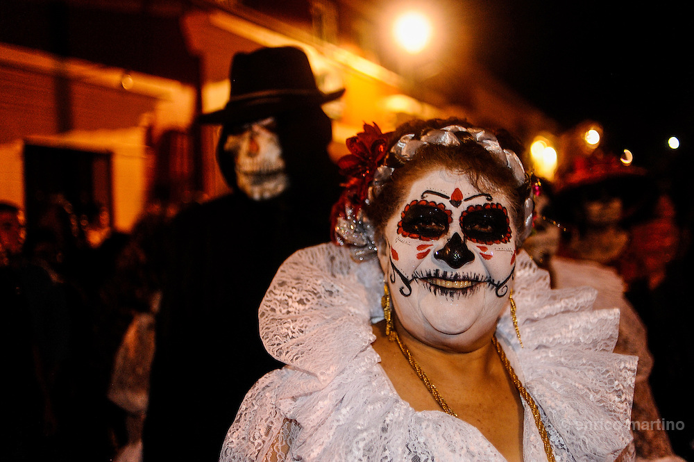 The traditional masks of skulls for the Day of the Dead. In the cities the celebrations are sometimes irreverent.