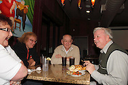 (from left) Nancy Dean, Karen Dean, Karl Dean and Riverside mayor Bill Flaute as Riverside Area Chamber of Commerce hosts an International Night featuring Indian and American food at the Filling Station Sports Bar & Grill in Riverside, Monday, March 26, 2012.  Owner Doctor Suresh Gupta prepared Indian cuisine including Bean Sprout Cucumber Salad, Butter Chicken, Samosas, Rice/Naan Bread and Veggie Khorma.