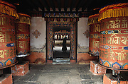 Prayer wheels at the entrance of Jambey Khakhang are filled with prayers, which are said as the wheels are spun by observant Buddhist visitors.