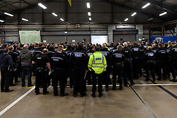 © Licensed to London News Pictures.  06/12/2012. MILTON KEYNES, UK. COLLECT PHOTO FROM TVP. Police officers receive a briefing as part of Operation Rouse. A total of 22 warrants were executed under the Misuse of Drugs Act in the Milton Keynes area this morning, with a further four carried out in the Metropolitan Police area and one in Northampton. 240 police officers were involved and 21 people arrested. A quantity of drugs, cash and weapons were seized. Photo credit :  TVP/LNP