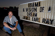"Pat Lanzo sits in front of the sign outside his ""Peach Bar"" in Paulding County, Georgia which he owns the day after the 2008 election in which Barack Obama was elected president of the United States.  Lanzo claims he is not a racist even though he constantly uses the word ""nigger"" on the sign in front of  his bar which he calls the  ""Original Klan Bar"" on his website. ""The minute someone says the N-word, you're labeled racist,"" he explains."