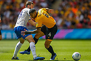 Tranmere Rovers midfielder Jay Harris (8) fouls Newport County midfielder Joss Labadie (4) during the EFL Sky Bet League 2 Play Off Final match between Newport County and Tranmere Rovers at Wembley Stadium, London, England on 25 May 2019.