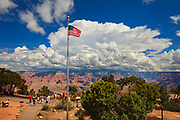 The American flag flying proudly at Grand Canyon National Park in Arizona.